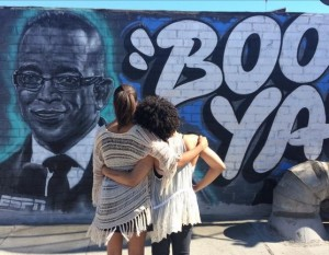 Stuart Scott's daughters, Taelor and Sydni look at the mural in their father's memory. Credit: http://www.vibe.com/2015/07/stuart-scott-mural/